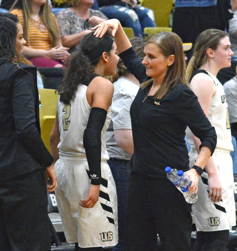 Upperman head coach Dana McWilliams, right, celebrates with Akira Levy after the Lady Bees' 74-50 win over Meigs County on Saturday in a sub-state game at UHS.