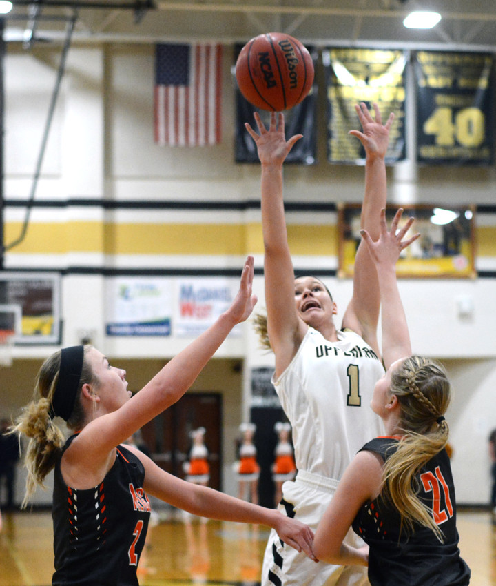 Upperman's Riley Hurst, center, puts up a contested shot during the Lady Bees' 74-50 win over Meigs County on Saturday in a sub-state game at UHS.