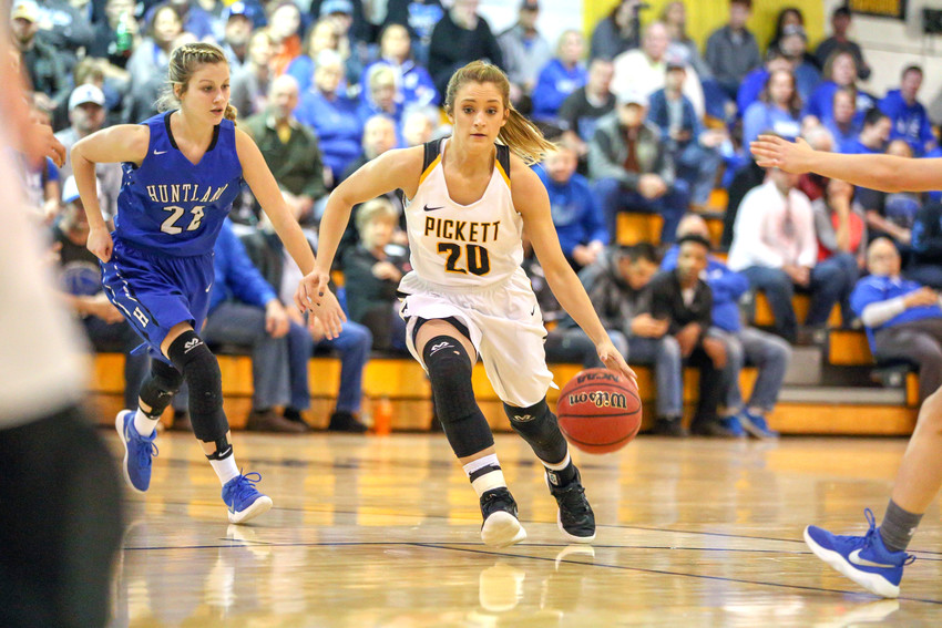 Gracie Martin drives to the basket in Pickett County's game Saturday with Huntland.