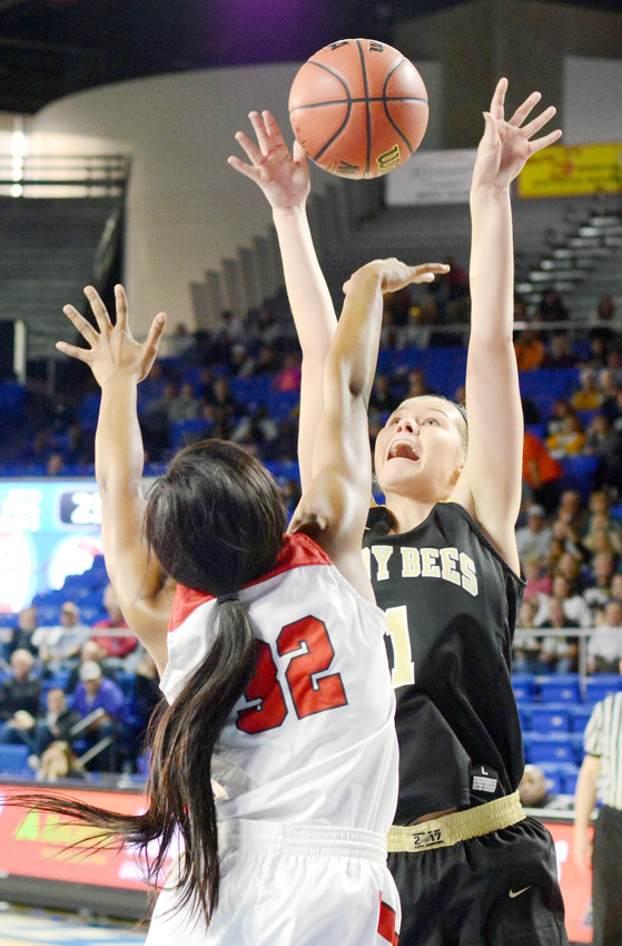 Upperman High School's Riley Hurst shoots over an East Nashville player during first-round action Thursday in the state basketball tournament in Murfreesboro. Upperman won the game, 62-51.