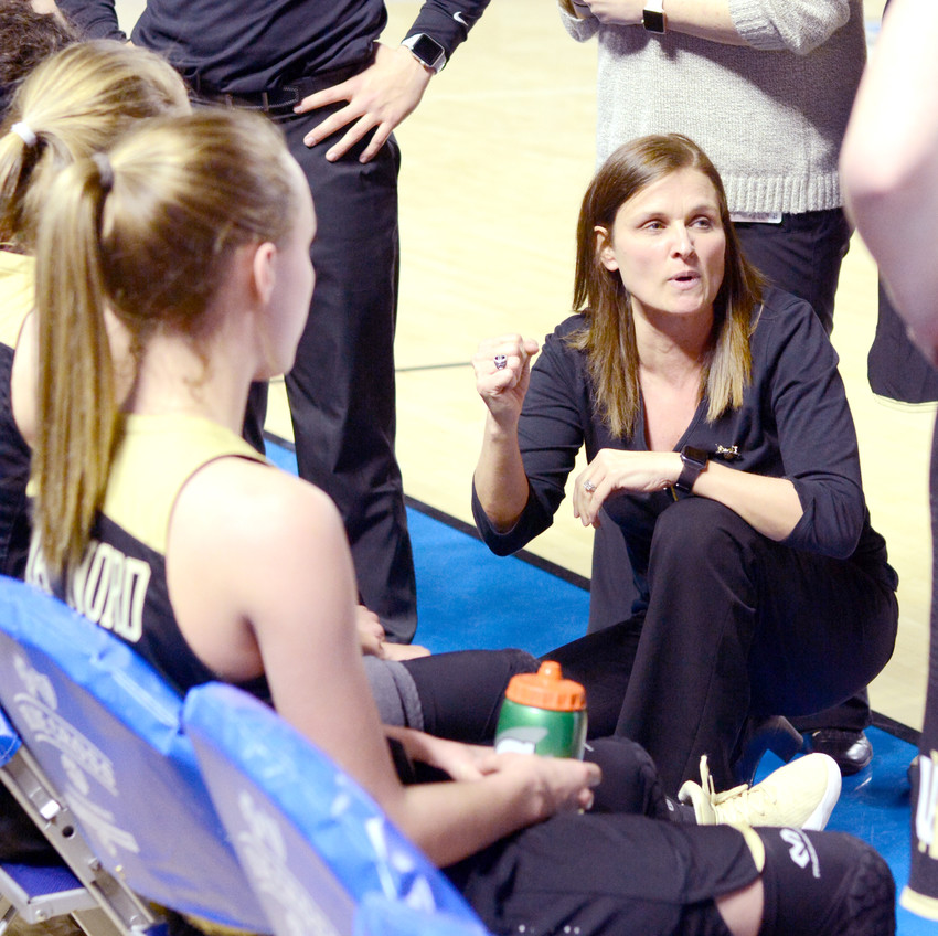Upperman coach Dana McWilliams talks to her team during a break in the action.