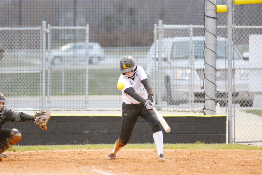 Upperman's Hannah Hughes fouls off a pitch during the Lady Bees' win Monday over Red Boiling Springs.