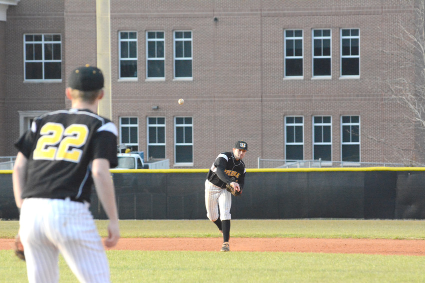 Shortstop Dylan Yoder fires to Craig Mangrum for the out at first base.
