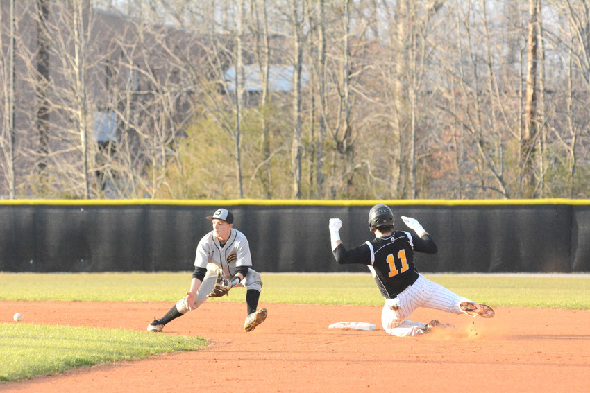 Upperman's Logan Cole slides into second base ahead of the throw.