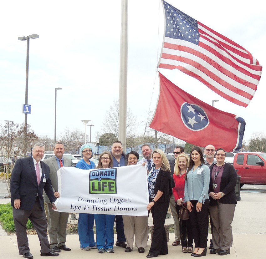 Officials with Cookeville Regional Medical Center recently recognized April as National Donate Life Month with a flag raising. From left are Scott Williams, COO at CRMC; Paul Korth, CEO at CRMC; Kara Mathis, donation committee member; Angela Craig, co- chair donation committee at CRMC; David Philips, chair of donation committee at CRMC; Danette Gardenhire, donation committee member; Alan Spriggs; Tennessee Donor Services; Kelly Noel, Tennessee Donor Services; Scott Lethi, CNO at CRMC; Wendy Arnett, donation committee member; Brittany Solada; Tennessee Donor Services; Joe Iwanyszyn, Plant Facilities Director; Angel Troxell, donation committee member.
