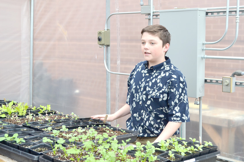 Prescott South Middle School student Jaxon Whitson gives a talk about plants being grown in the school's greenhouse.