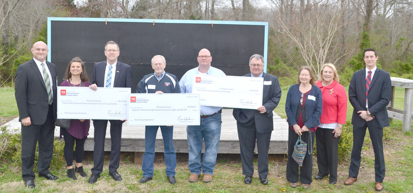 Putnam County has received several hundred thousand dollars in grants from the Tennessee Department of Environment and Conservation. From left are Director of Schools Jerry Boyd, school board member Celeste Gammon, County Executive Randy Porter, Solid Waste Director Keith Street, Assistant Director Doug Ashburn, TDEC Commissioner Bob Martineau, Lisa Luck, Lisa Hughey and Lynn Tutor.