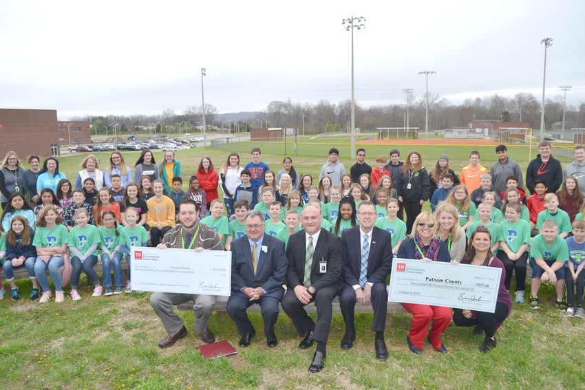 Students involved in the horticulture programs at Prescott South elementary and middle schools surround officials who gathered to accept grant monies for a composting pilot project at the school.