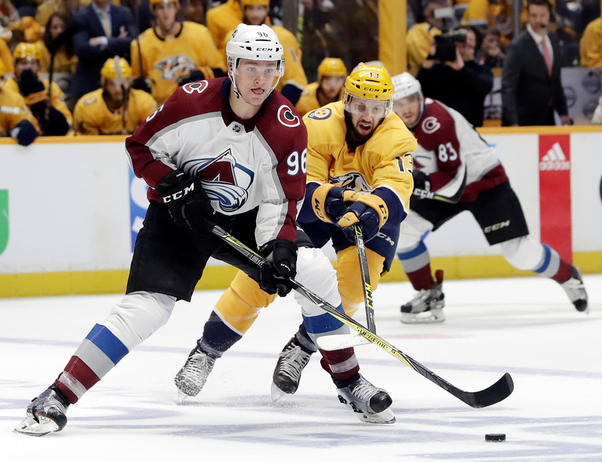 Colorado Avalanche right wing Mikko Rantanen (96), of Finland, moves the puck ahead of Nashville Predators defenseman Nick Bonino (13) during the first period in Game 2 of an NHL hockey first-round playoff series Saturday, April 14, 2018, in Nashville, Tenn. (AP Photo/Mark Humphrey)