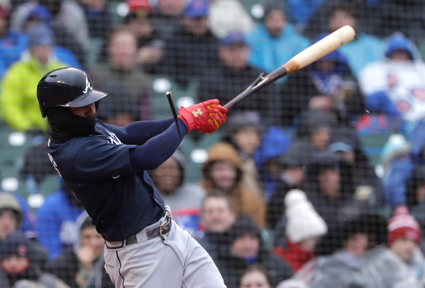 Atlanta Braves' Ozzie Albies breaks his bat as he hits a one-run double against the Chicago Cubs during the second inning of a baseball game Saturday, April 14, 2018, in Chicago. (AP Photo/Nam Y. Huh)