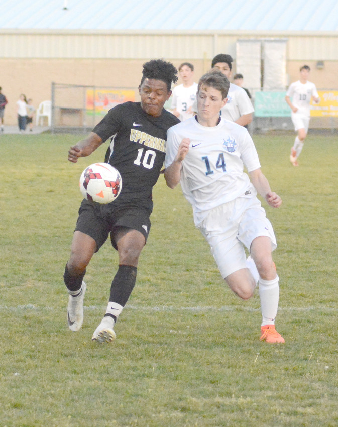 Upperman's Teyo Rodriguez, above, left, battles a Cumberland County defender. Rodriguez scored three goals.