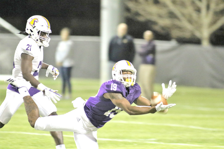Tennessee Tech's R.D. Ford, right, makes a diving attempt at a catch while Dami Adekunjo defends during TTU's spring game Friday night at Tech.