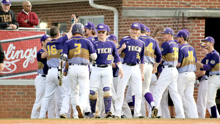 Tennessee Tech's John Ham (3) is greeted at the plate by John Elford (15) after Ham scores during a recent game. The Golden Eagles beat Murray State University 23-7 Sunday to run their winning streak to 20 games. The Golden Eagles visit Western Kentucky University on Tuesday.