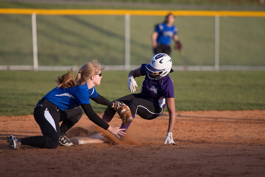 Kyleigh Thornton slides into second base ahead of the Wartburg tag.