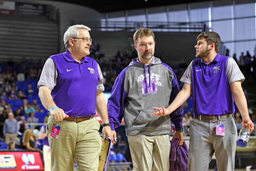Monterey high School Head Basketball Coach Adam West, center, guided his team to this year's state semifinals. He was named the Herald-Citizen Coach of the Year.