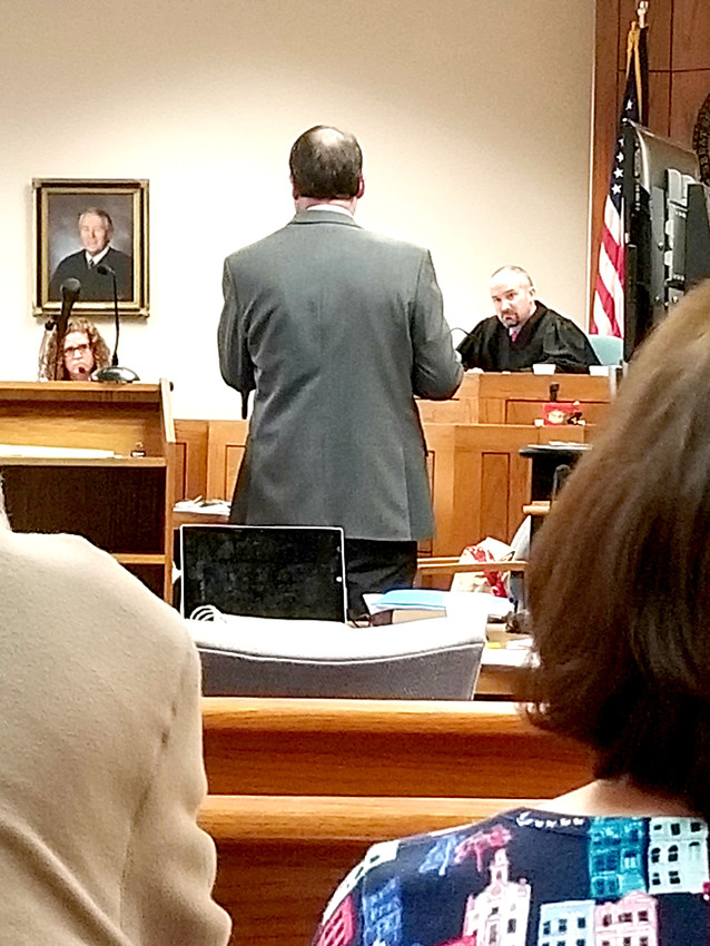 Assistant District Attorney Bret Gunn questions medical examiner Dr. Emily Dennison, left, during the second day of the murder trial of Willie Nathan Jones, accused in the 2015 murder of Rodney Richards. The trial resumed this morning in Putnam Criminal Courtroom of Judge Gary McKenzie, right.