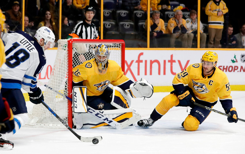 FILE - In this Nov. 20, 2017, file photo, Nashville Predators goalie Pekka Rinne (35), of Finland, and defenseman Roman Josi (59), of Switzerland, guard the net as Winnipeg Jets center Bryan Little (18) shoots in the third period of an NHL hockey game, in Nashville, Tenn. The Predators take on the Jets in the Western Conference semifinals beginning Friday, April 27, at Nashville. (AP Photo/Mark Humphrey, FIle)