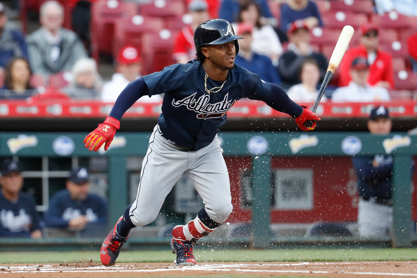 Atlanta Braves' Ozzie Albies watches his RBI single off Cincinnati Reds starting pitcher Brandon Finnegan during the first inning of a baseball game Wednesday, April 25, 2018, in Cincinnati. (AP Photo/John Minchillo)