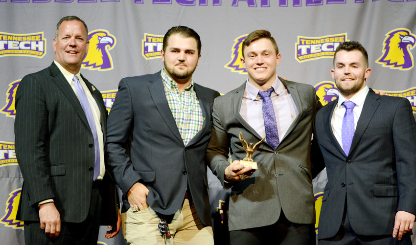 Tennessee Tech's (from right) Trevor Putzig, Kevin Strohschein, and Chase Chambers receive the Male Athlete of the Year award from TTU Athletic Director Mark Wilson on behalf of Ryan Flick on Thursday night in the Hooper Eblen Center.