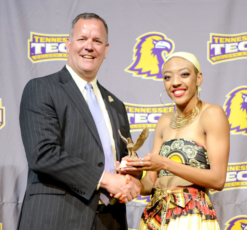 Tennessee Tech's Na'Asha Robinson, right, receives her Female Athlete of the Year award from TTU Athletic Director Mark Wilson on Thursday night in the Hooper Eblen Center.