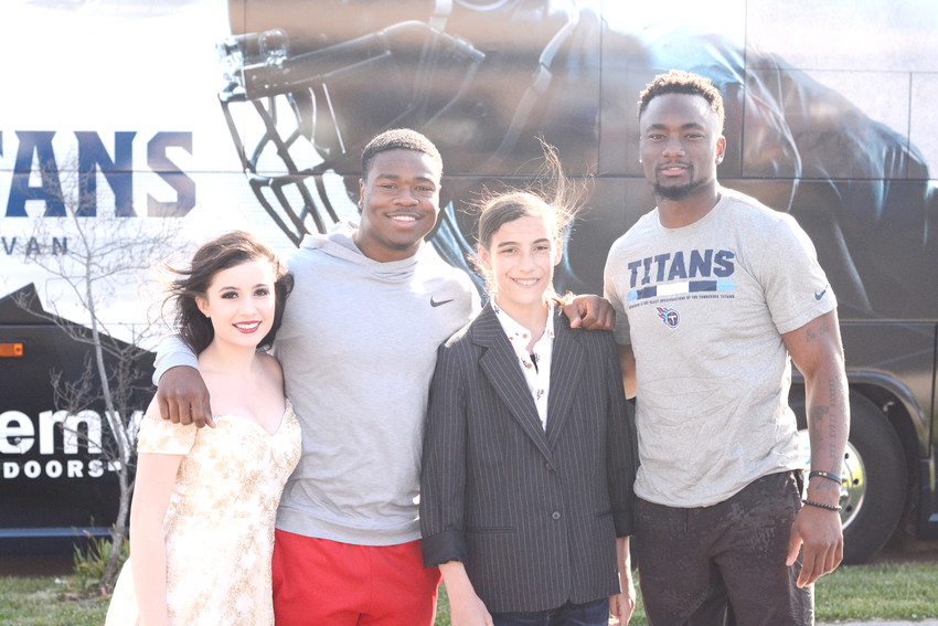 Tennessee Titans' Corey Davis, right, and Jayon Brown (second from left) act as temporary prom dates for Zaidea Bohannon, left, and brother Zeke Bohannon