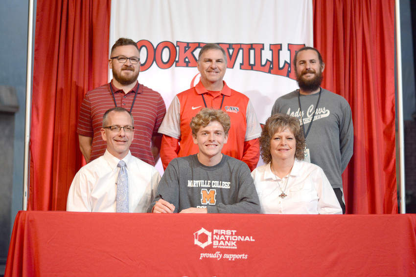 Cookeville's Josh Campbell (front, center) signs his national letter of intent to play soccer for Maryville College. The signing was witnessed by (front row, from left) father David Campbell, mother Lori Campbell, (back row, from left) CHS assistant coach Will Putman, CHS athletic director Steve Robbins, and CHS head coach Sam Matson.