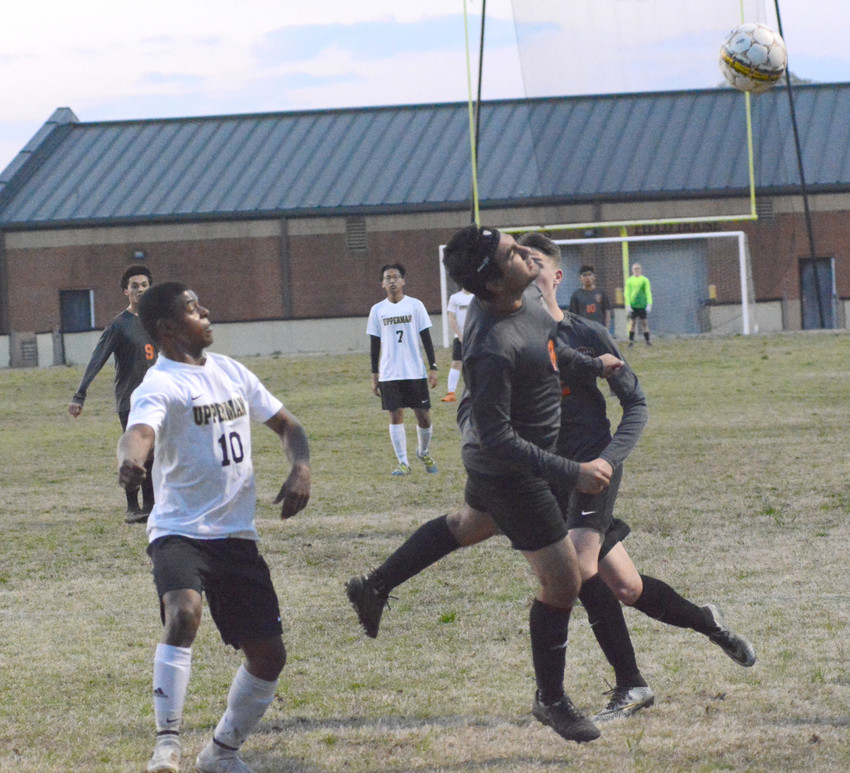 Teyo Rodriguez prepares for the ball as it soars over a defender.