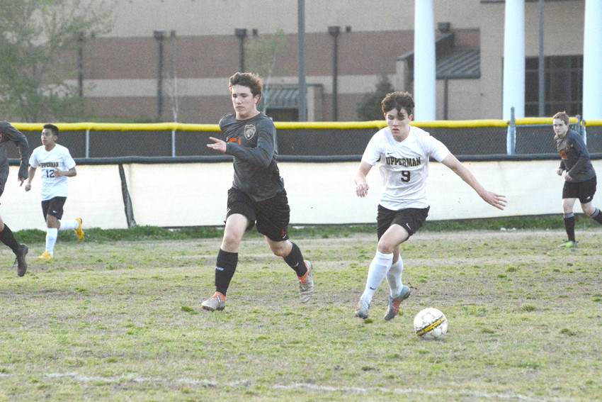 Upperman's Landon Walters (9) take the ball down the field.