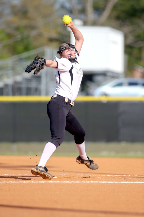 Upperman High School's Abby Gatlin fires to the plate during the Lady Bees' victory over Macon County earlier this week.