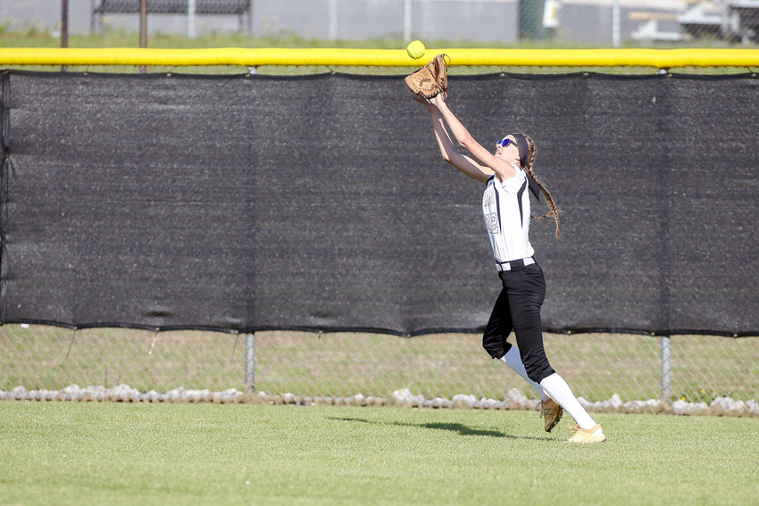 Reagan Hurst tracks down a fly ball in the outfield.