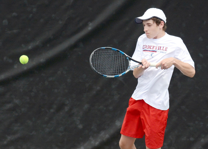 Cookeville's Ben Silberman returns a serve during Thursday's District 6-AAA Tournament action at Tennessee Tech's tennis courts.