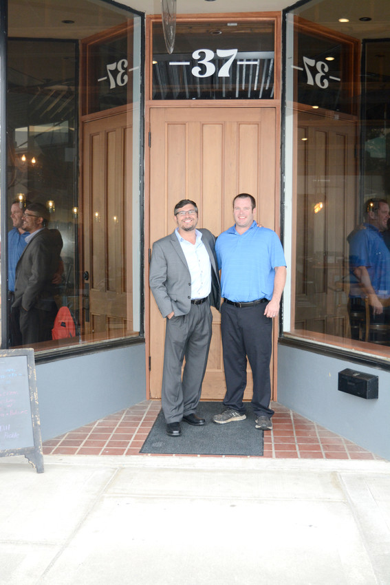 Owners Kevin Maxwell, left, and Chris Batty pose for a photo in front of their 37 Cedar Restaurant & Bar.
