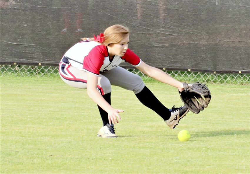 Cookeville's Jordyn Wagner reaches to field a ground ball in right field.