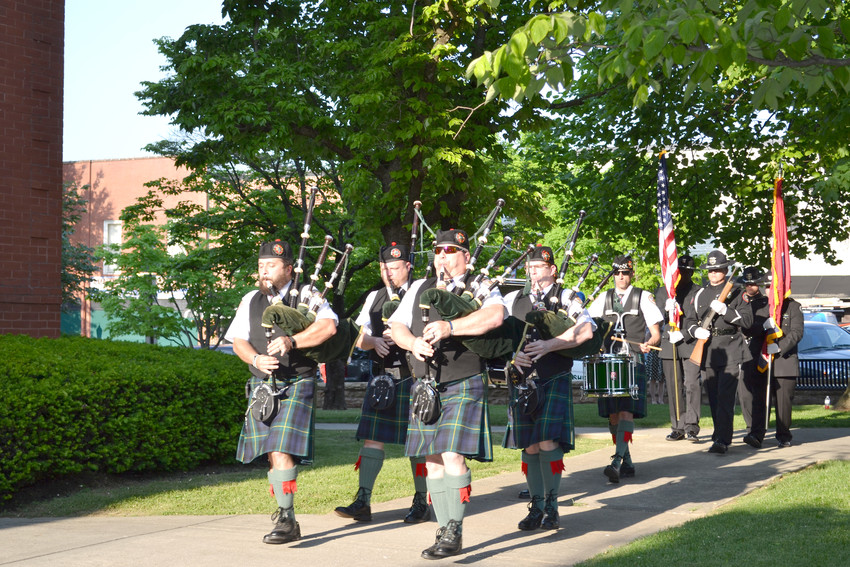Members of the Shelby County Sheriff's Office play the bagpipes and drums during a Putnam County Sheriff's Office memorial service for fallen officers Monday evening at the Putnam County Courthouse.