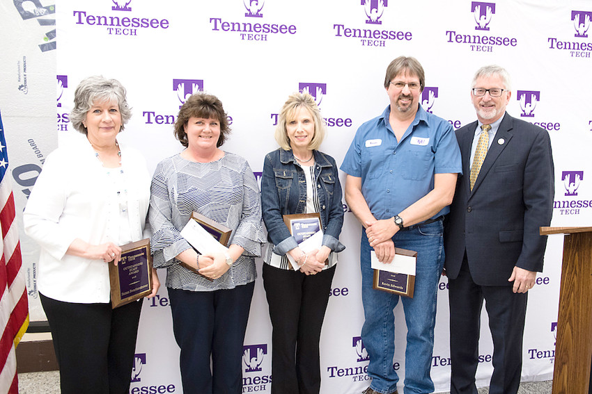 Tennessee Tech University Outstanding Clerical and Support Staff Awardees, from left, Susan Swartzentrover, Lisa Rice, Kathy Hammons and Kevin Edwards are congratulated by Tech President Phil Oldham.