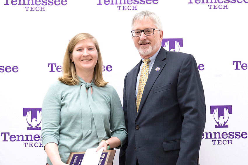 Tennessee Tech University Outstanding Professional Staff Awardee Kelly Chambers is congratulated by Tech President Phil Oldham.