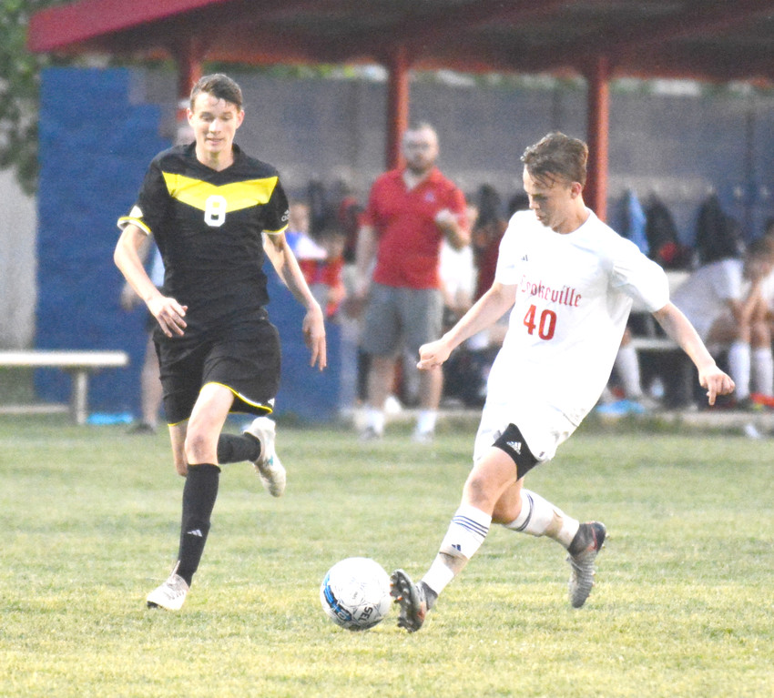 Cookeville's Caden Wilcox, right, dribbles around a McMinn County defender during the Cavaliers' 5-0 victory Tuesday.