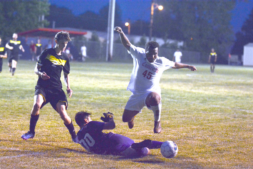 Ryan Lombardo goes high to avoid the McMinn County goalkeeper.