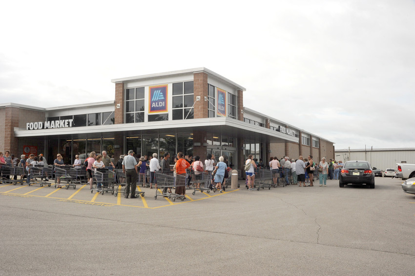 Shoppers were wrapped around the building as Aldi had its grand reopening Wednesday. The grocery store had closed for a month to expand its building and redesign the layout.