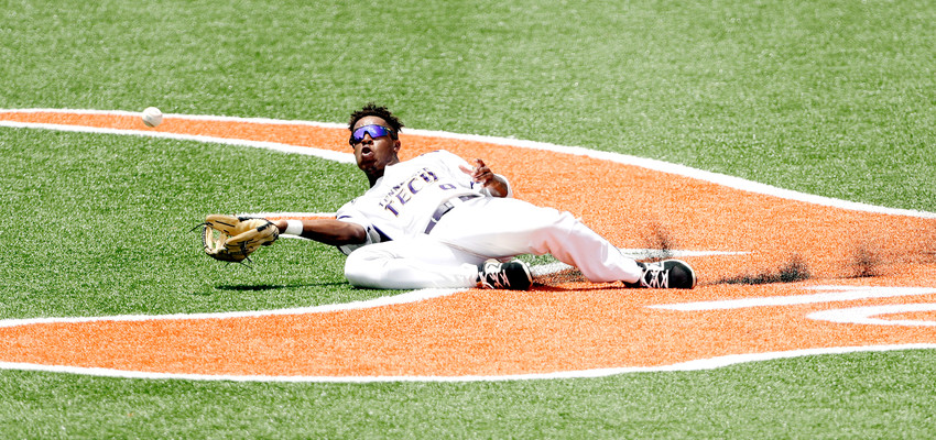 Tennessee Tech outfielder Alex Junior (9) makes a diving catch hit by Texas infielder David Hamilton in the second inning of an NCAA college super regional baseball game Sunday in Austin, Texas.