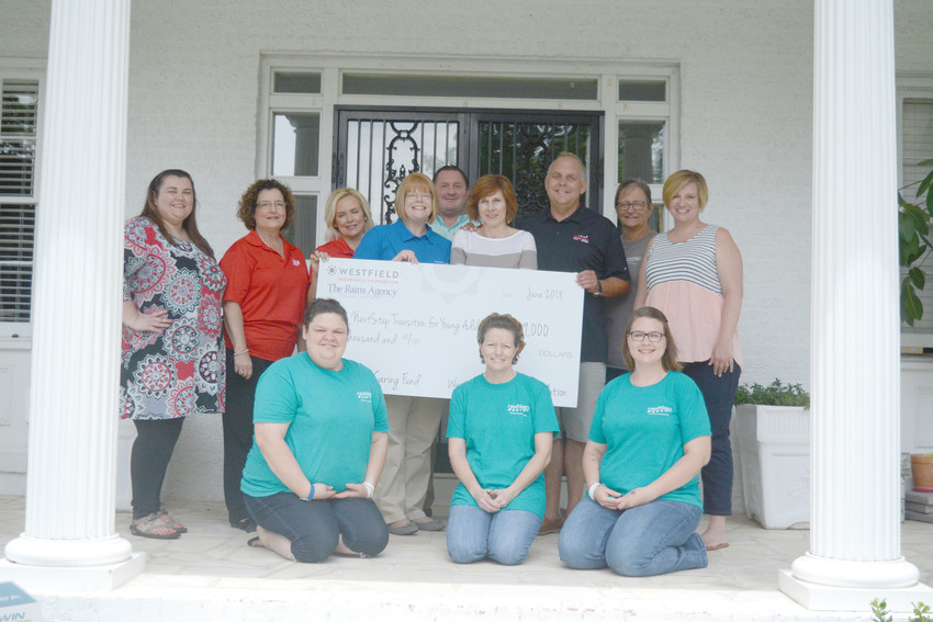 Next Step for Life received a $9,000 grant Friday from The Rains Agency and Westfield Insurance Foundation. Front, from left is R. Cole, R. Flake and A. Spangler, who are all current residents at Next Step for Life. Back, from left is Karley Smith, a Next step volunteer; Marilyn Mullinix with Progressive Savings Bank; Emily Rains and Jessica Parrott with the Rains Agency; Scott Davison, a Next Step board member; Diane Roland, Next Step executive director; Dave Roland, Diane's husband and Next Step board member; Niki Payne, Next Step program coordinator and house manager; and Christy Duncan, Next Step volunteer coordinator.