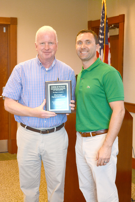 Power of Putnam's Partner of the Month for June is Heath Waters. Power of Putnam's executive director, Bill Gibson, said Waters is an advocate for Power of Putnam and his community. Gibson, left, presenters Waters with his award at the Power of Putnam June meeting.