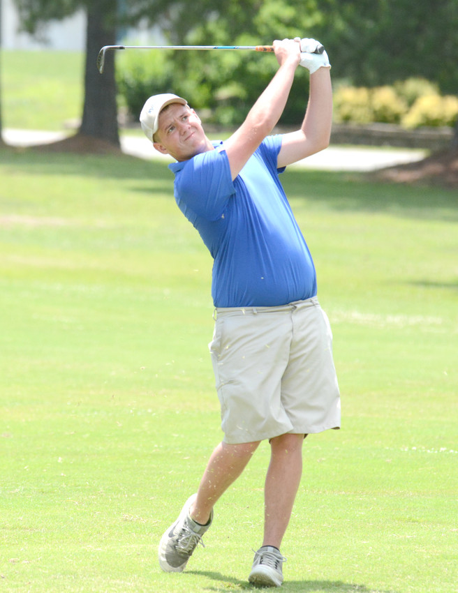 Cookeville's Matther Harris watches his chip shot during the second round of a Tennessee Junior PGA Championship qualifier at the Golden Eagle Golf Club on Tuesday.
