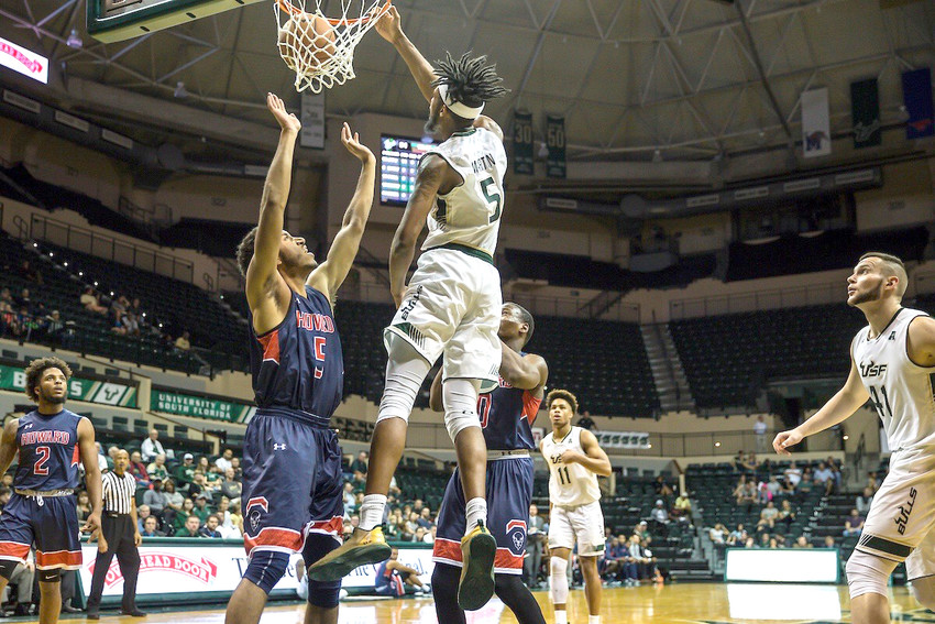 University of South Florida graduate transfer Malik Martin goes up for a dunk during a Bulls' game last season. The 6-foot-11 big man has transferred to Tech for his final year of eligibility.