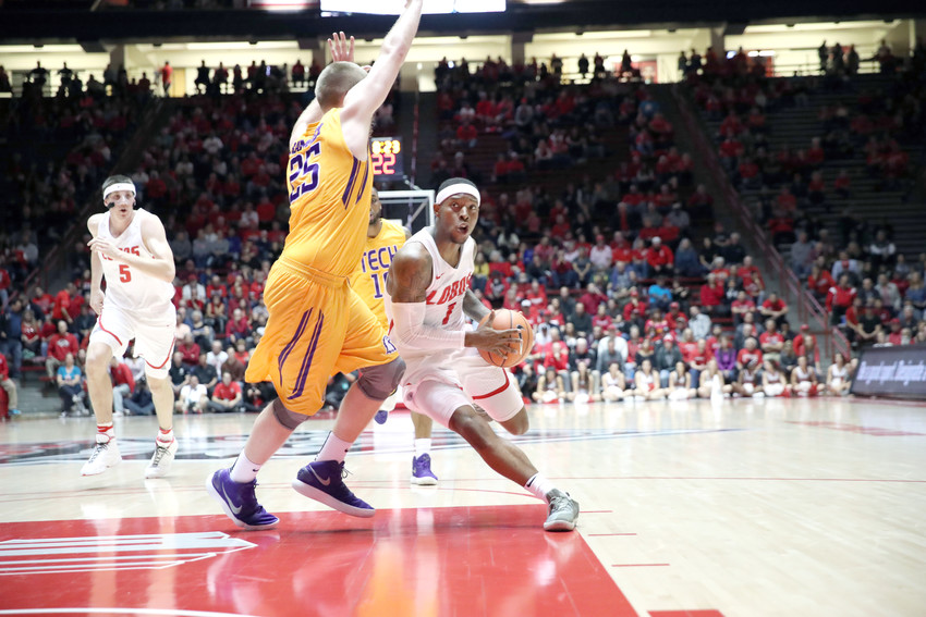 New Mexico's Chris McNeal, right, tries to get around Tennessee Tech's Mason Ramsey during a game earlier in the year at UNM.