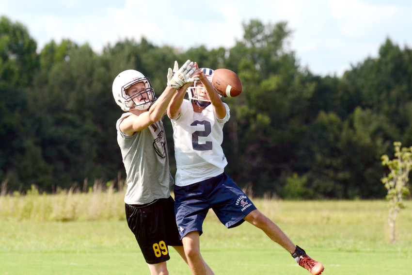 Upperman High School's Trey Snider, left, battles Cookeville's Ben Durand for the football during a 7-on-7 competition Monday at Cookeville High School. Teams from around the region will be competing through today at the school's soccer complex. CHS and Upperman will open the 2018 season against each other on Aug. 17.