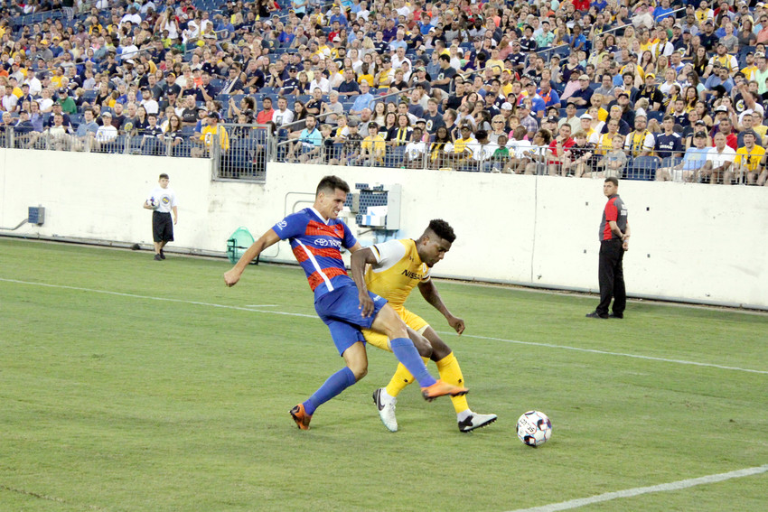 Nashville SC's Bradley Bourgeois, right, battles Cincinnati's Danni Konig for a lose ball during action Saturday night.