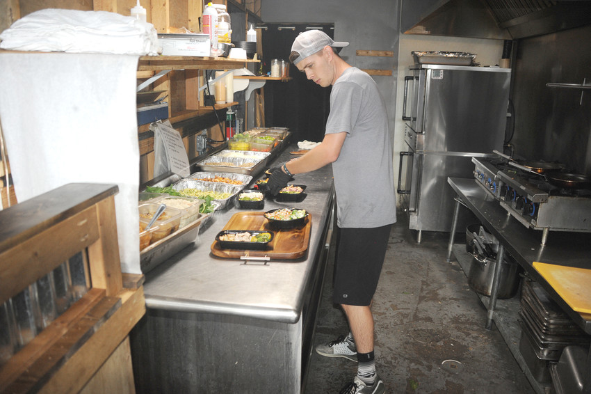Mealfit's Keith Martin making some of the company's popular power bowls.