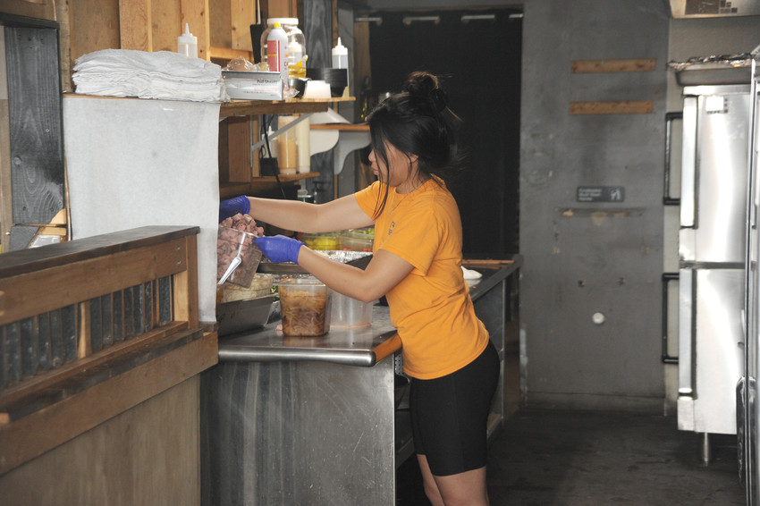 Ling Phongsa providing food for the prep area in Mealfit.