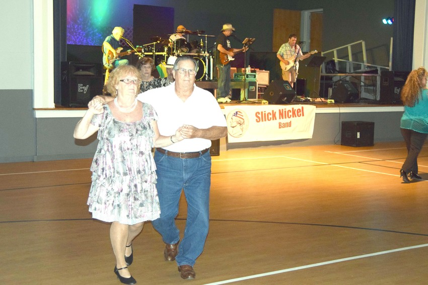 Rita and Bob Stafford dance to the music of the Slick Nickel band.